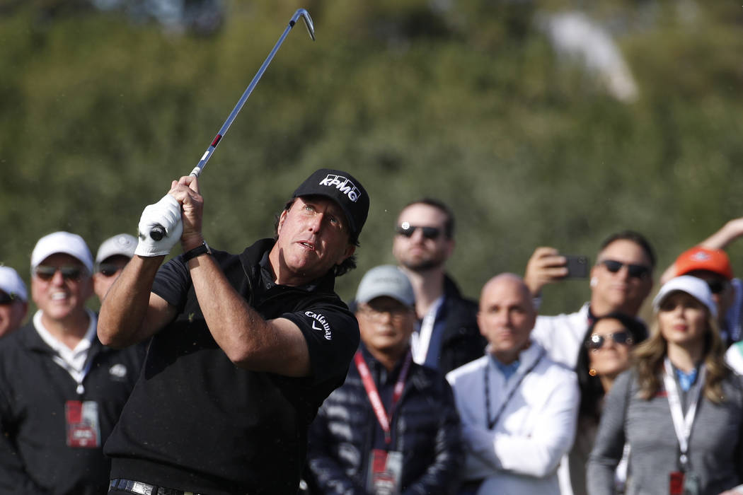 Phil Mickelson hits off the second fairway during a golf match against Tiger Woods at Shadow Creek golf course, Friday, Nov. 23, 2018, in Las Vegas. (AP Photo/John Locher)