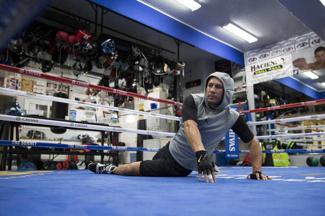 """Gennady Golovkin stretches during a workout at The Summit Gym in Big Bear Lake, Calif., on Wednesday, July 26, 2017. Golovkin is training for his September 16 boxing bout against Saul """"Canelo"""" Alv ..."""