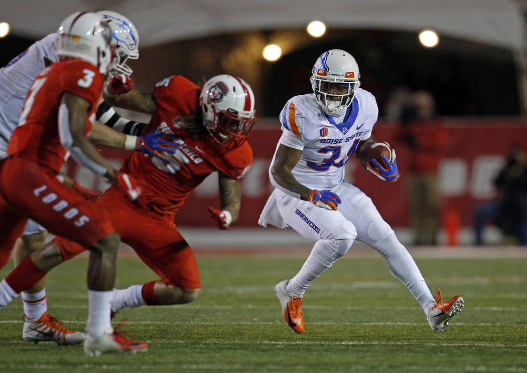 Boise State running back Robert Mahone (34) runs for yardage during the second half of an NCAA college football game against New Mexico in Albuquerque, N.M., Friday, Nov. 16, 2018. (AP Photo/Andre ...