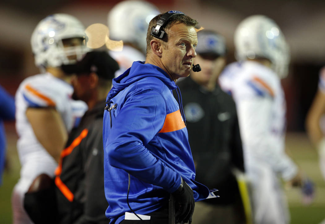 Boise State coach Bryan Harsin talks on his headphones during the second half of an NCAA college football game against New Mexico in Albuquerque, N.M., Friday, Nov. 16, 2018. (AP Photo/Andres Leig ...