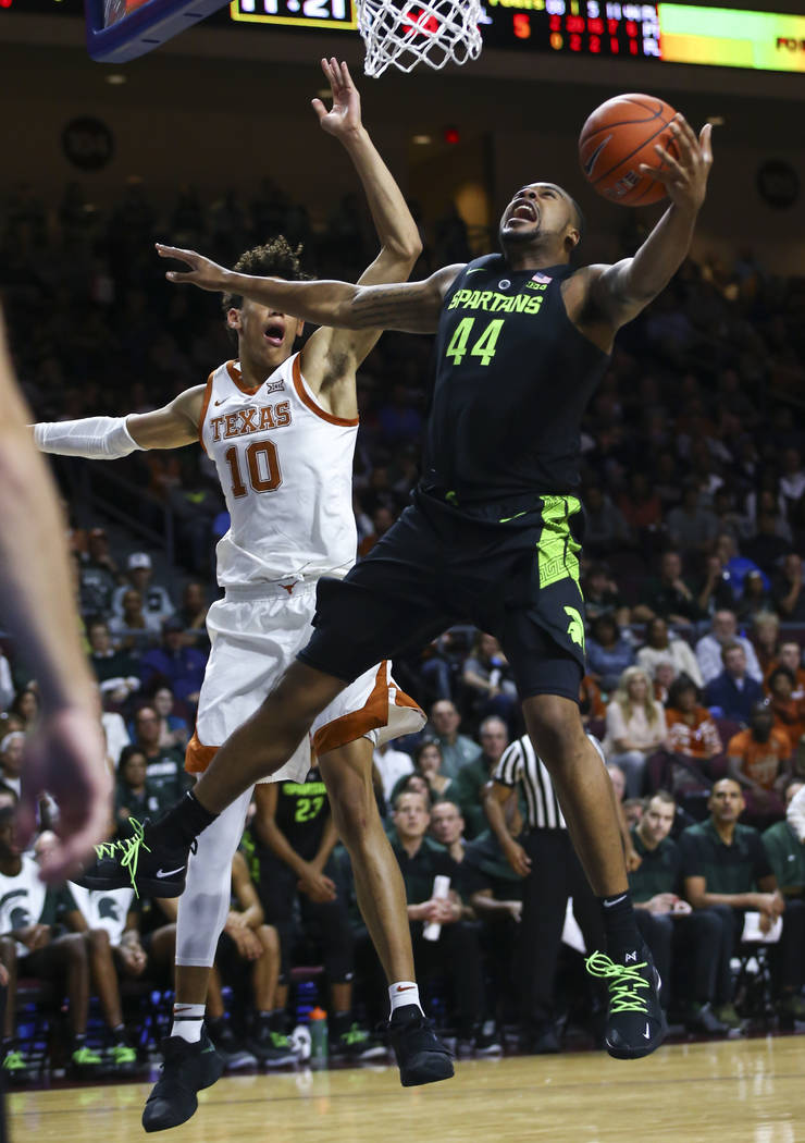 Michigan State's Nick Ward (44) is fouled by Texas' Jaxson Hayes (10) while going to the basket during the second half of an NCAA college basketball game Friday, Nov. 23, 2018, in Las Vegas. (AP P ...