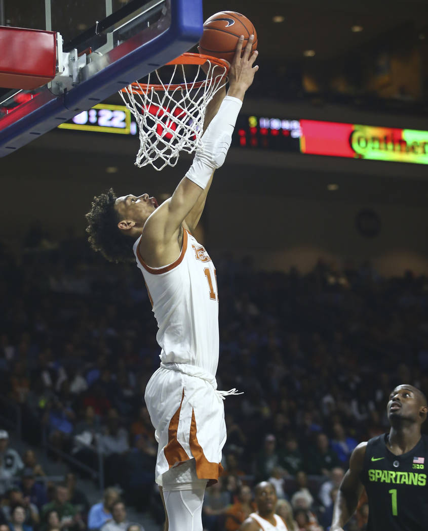 Texas' Jaxson Hayes goes to the basket on an alley-oop pass against Michigan State during the first half of an NCAA college basketball game Friday, Nov. 23, 2018, in Las Vegas. (AP Photo/Chase Ste ...