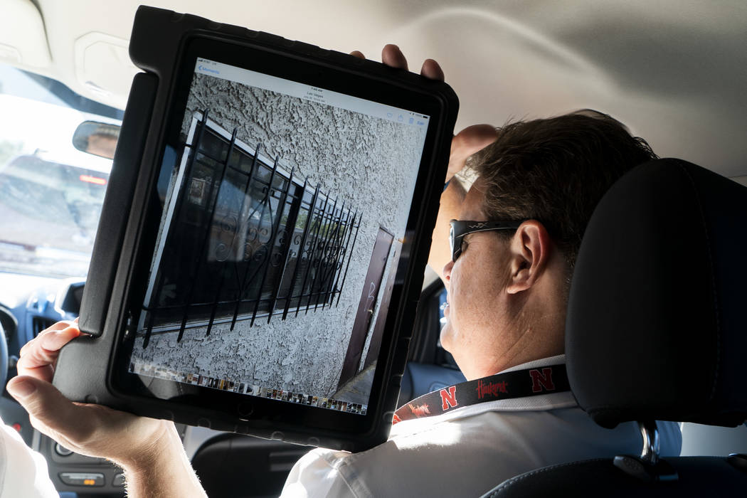 Scott Thompson, fire inspector for Las Vegas Fire and Rescue, holds up a photo he took of a safety hazard at an apartment complex in Las Vegas, Thursday, Sept. 6, 2018. (Marcus Villagran/Las Vegas ...