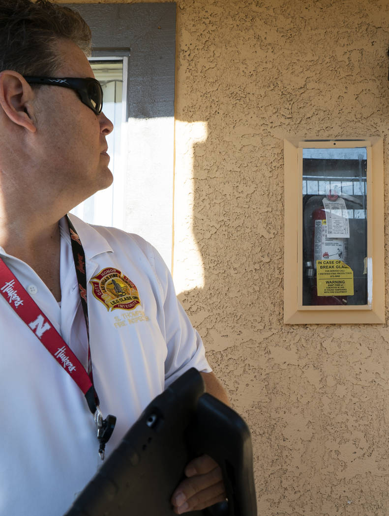 Scott Thompson, fire inspector for Las Vegas Fire and Rescue, conducts a fire safety inspection at an apartment complex in the Central Valley off Jones Boulevard in Las Vegas, Thursday, Sept. 6, 2 ...