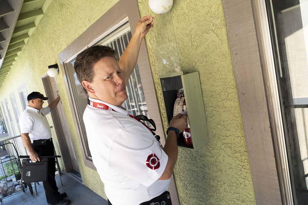 Todd Riley, left, and Scott Thompson, fire inspectors for Las Vegas Fire and Rescue, conduct a fire safety inspection at an apartment complex in the Central Valley off Jones Boulevard in Las Vegas ...