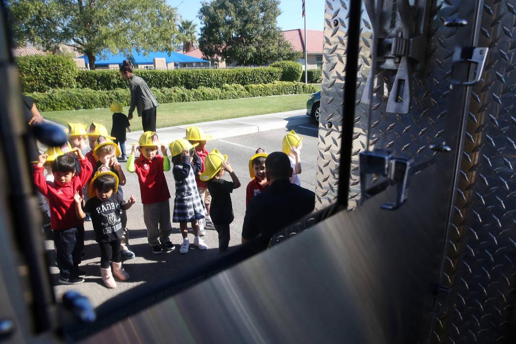 Children wait in line to see a Clark County Fire Department engine at Merryhill Preschool, 5055 S. Durango Dr., in Las Vegas, Wednesday, Oct. 24, 2018. Erik Verduzco Las Vegas Review-Journal @Erik ...