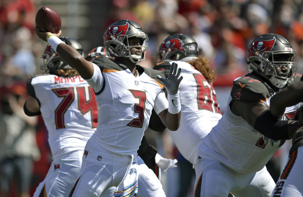 Tampa Bay Buccaneers quarterback Jameis Winston (3) throws a pass against the Cleveland Browns during the first half of an NFL football game Sunday, Oct. 21, 2018, in Tampa, Fla. (AP Photo/Jason B ...