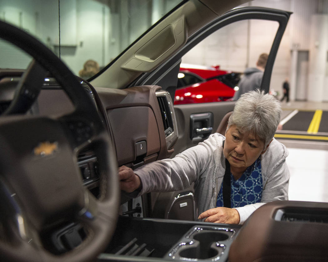 Las Vegas resident Lustre Handa checks out the interior features of one the cars on display at the 2019-Model Motor Trend International Auto Show at the Las Vegas Convention Center in Las Vegas, S ...