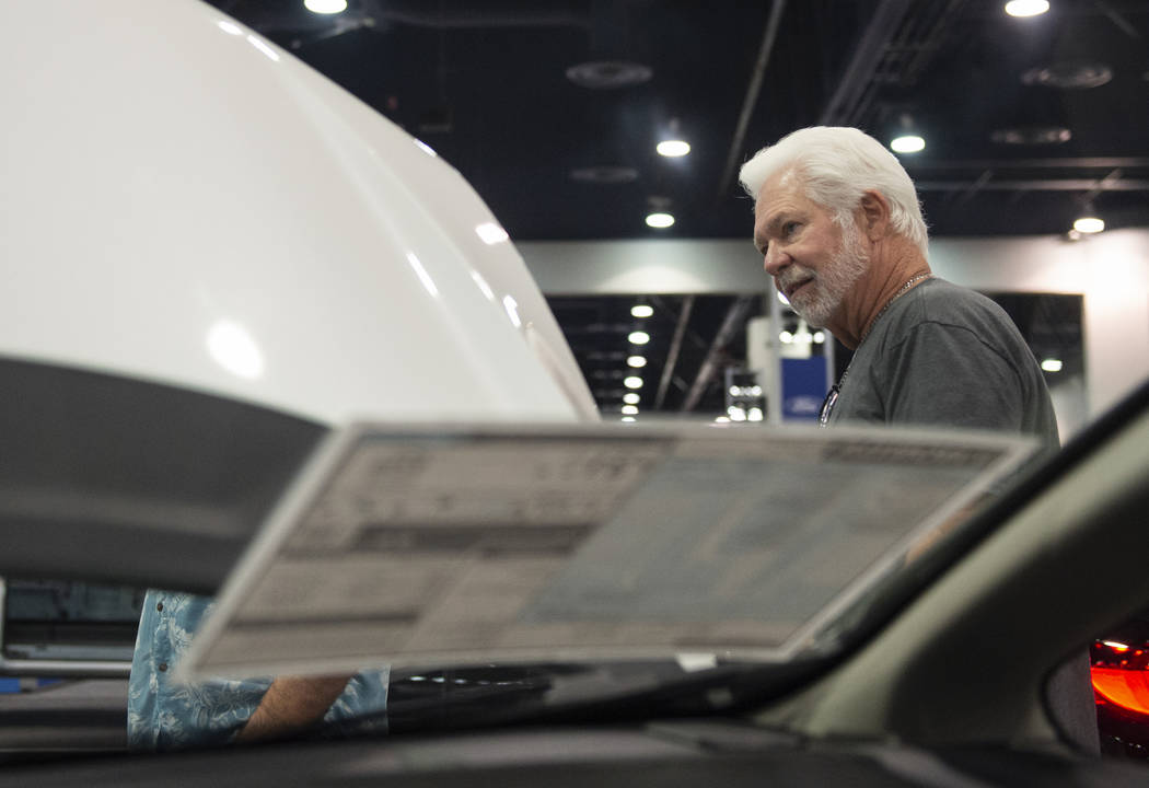 Las Vegas resident Randy Gilliam looks under the hood of one the cars on display at the 2019-Model Motor Trend International Auto Show at the Las Vegas Convention Center in Las Vegas, Sunday, Nov. ...