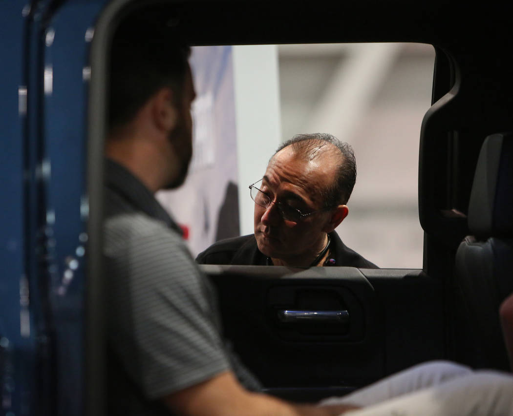 Las Vegas resident Dario Franco peers inside one of the cars on display at the 2019-Model Motor Trend International Auto Show at the Las Vegas Convention Center in Las Vegas, Sunday, Nov. 25, 2018 ...