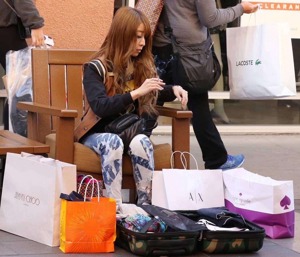 Rie Takeuchi of Japan takes a break after shopping during Black Friday at the North Premium Outlet Mall on Friday, Nov. 23, 2018. Bizuayehu Tesfaye Las Vegas Review-Journal @bizutesfaye