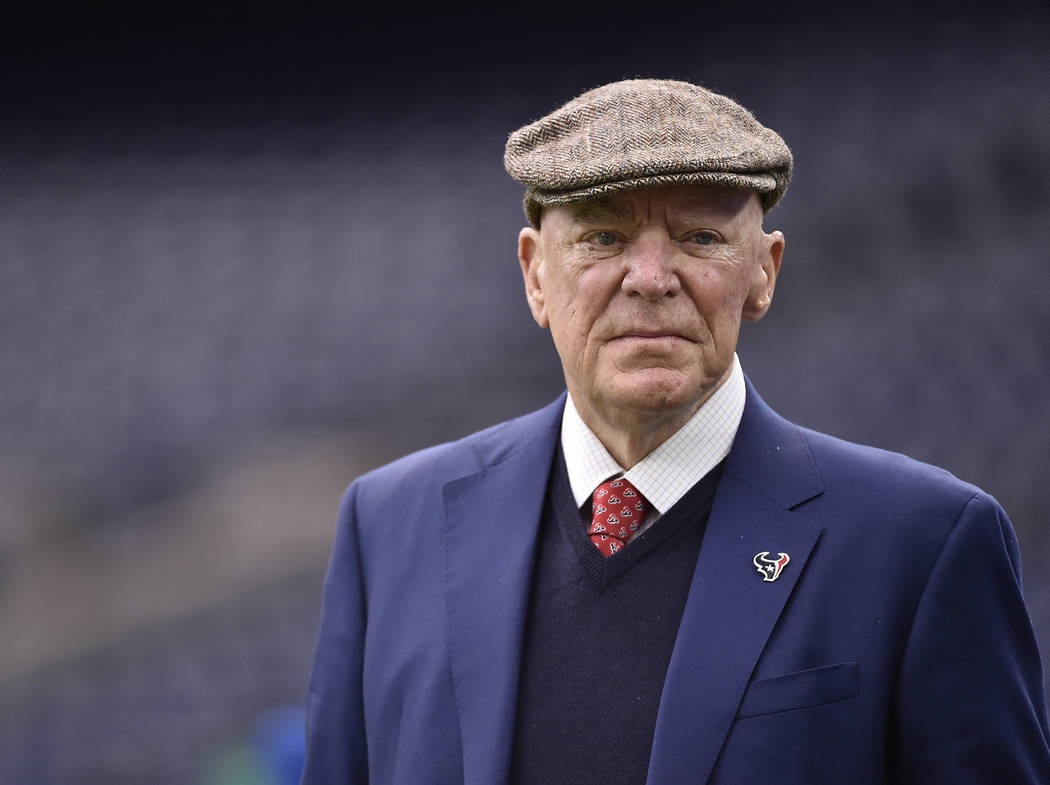 """In this Jan. 7, 2017, file photo, Texans owner Robert """"Bob"""" McNair walks on the turf before an AFC Wild Card NFL game between the Texans and the Oakland Raiders, in Houston. McNair, billionaire fo ..."""