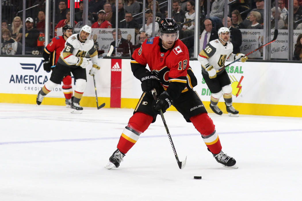 Calgary Flames left wing James Neal (18) moves the puck toward the Vegas Golden Knights goal during the second period of an NHL game in Las Vegas, Friday, Nov. 23, 2018. Heidi Fang Las Vegas Revie ...