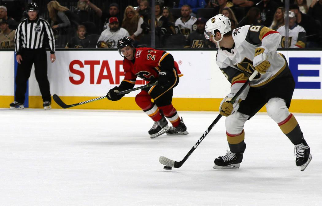 Vegas Golden Knights defenseman Colin Miller (6) skates by Calgary Flames center Austin Czarnik (27) during the second period of an NHL game in Las Vegas, Friday, Nov. 23, 2018. Heidi Fang Las Veg ...