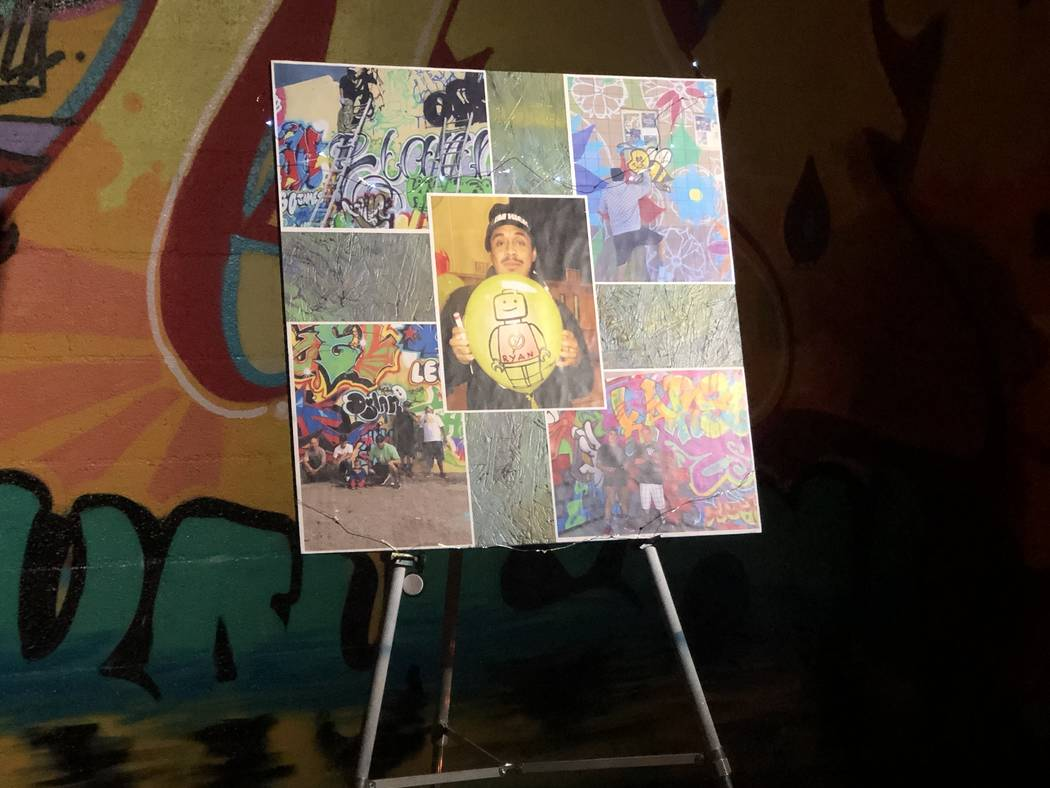A poster board with pictures of George Campoverde was set up at a vigil for the 29-year-old on Saturday, November 21, 2018. Campoverde died Wednesday, November 21, 2018, in a shooting that Las Veg ...