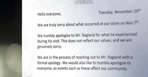 A note of apology is attached to the door of a closed frozen-yogurt shop Tuesday, Nov. 20, 2018, in Kirkland, Wash. The police department there has apologized for an incident in which officers hel ...