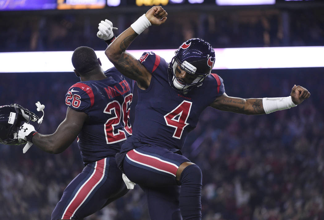 Houston Texans quarterback Deshaun Watson (4) and running back Lamar Miller (26) celebrate a touchdown against the Miami Dolphins during the first half of an NFL football game, Thursday, Oct. 25, ...