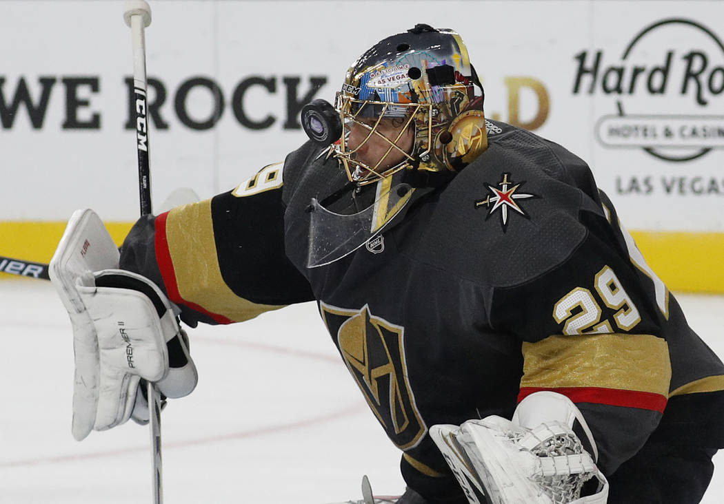 Vegas Golden Knights goaltender Marc-Andre Fleury makes a save against the San Jose Sharks during the first period of an NHL hockey game Saturday, Nov. 24, 2018, in Las Vegas. (AP Photo/John Locher)