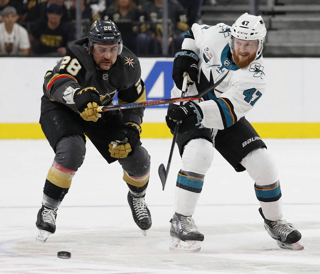San Jose Sharks defenseman Joakim Ryan (47) passes the puck past Vegas Golden Knights left wing William Carrier (28) during the first period of an NHL hockey game Saturday, Nov. 24, 2018, in Las V ...