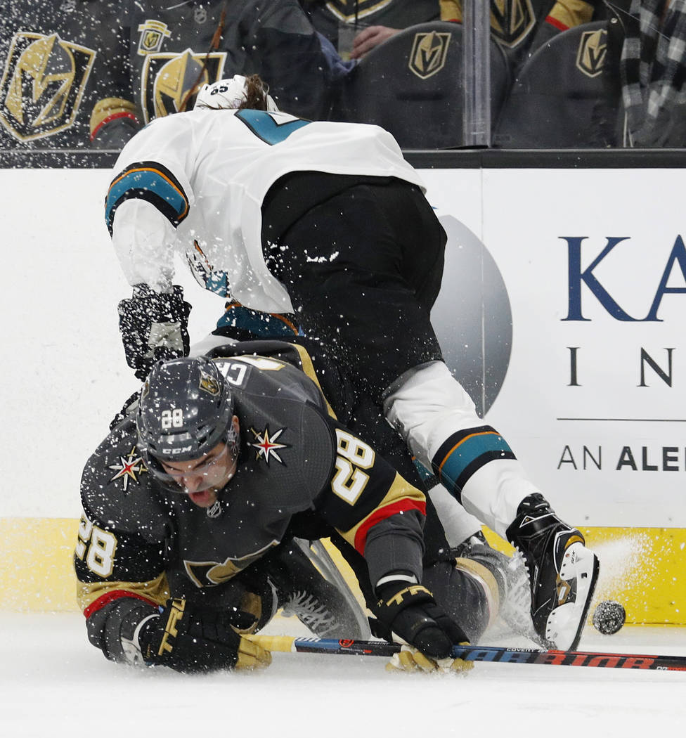 Vegas Golden Knights left wing William Carrier (28) falls against San Jose Sharks defenseman Erik Karlsson during the second period of an NHL hockey game Saturday, Nov. 24, 2018, in Las Vegas. (AP ...