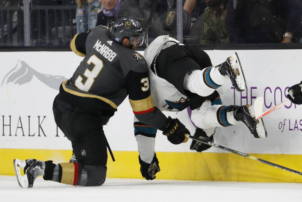 Vegas Golden Knights defenseman Brayden McNabb (3) checks San Jose Sharks right wing Joonas Donskoi (27) during the second period of an NHL hockey game Saturday, Nov. 24, 2018, in Las Vegas. (AP P ...