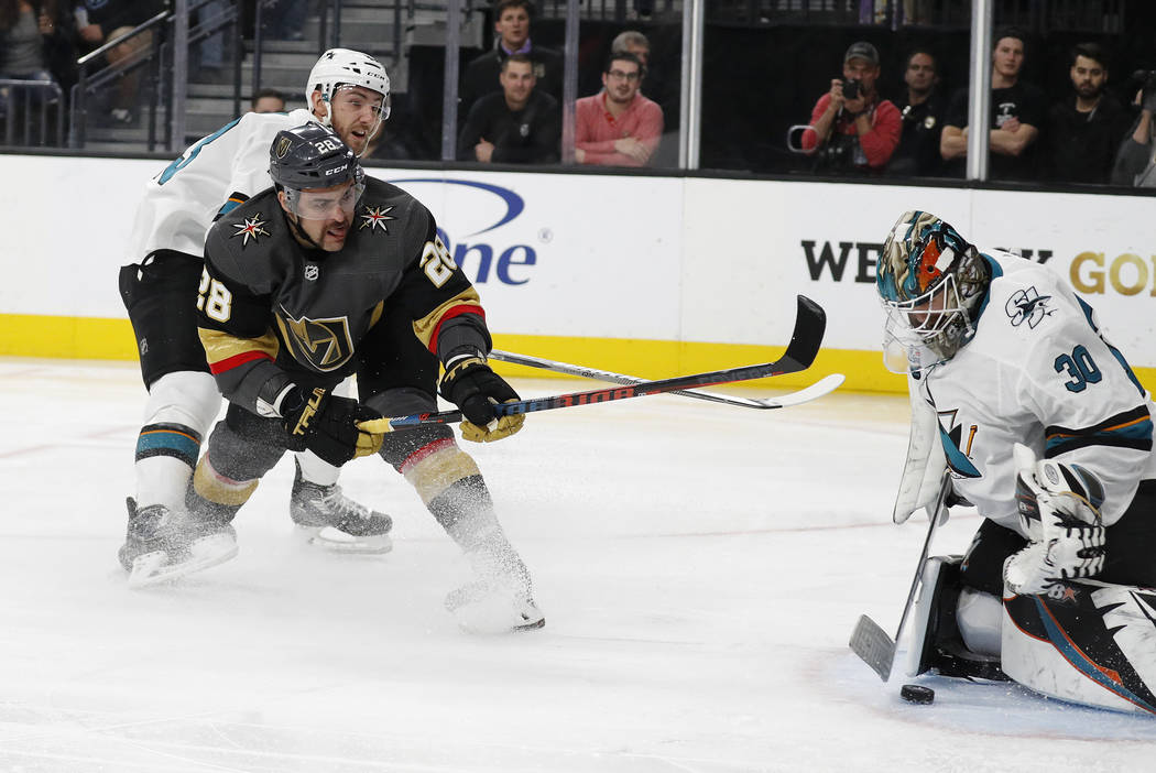 Vegas Golden Knights left wing William Carrier (28) scores on San Jose Sharks goaltender Aaron Dell (30) during the second period of an NHL hockey game Saturday, Nov. 24, 2018, in Las Vegas. (AP P ...