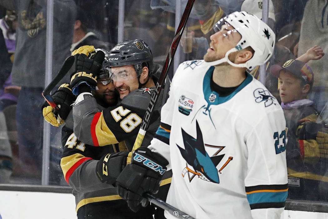Vegas Golden Knights center Pierre-Edouard Bellemare, celebrates after left wing William Carrier (28) scored against the San Jose Sharks during the second period of an NHL hockey game Saturday, No ...