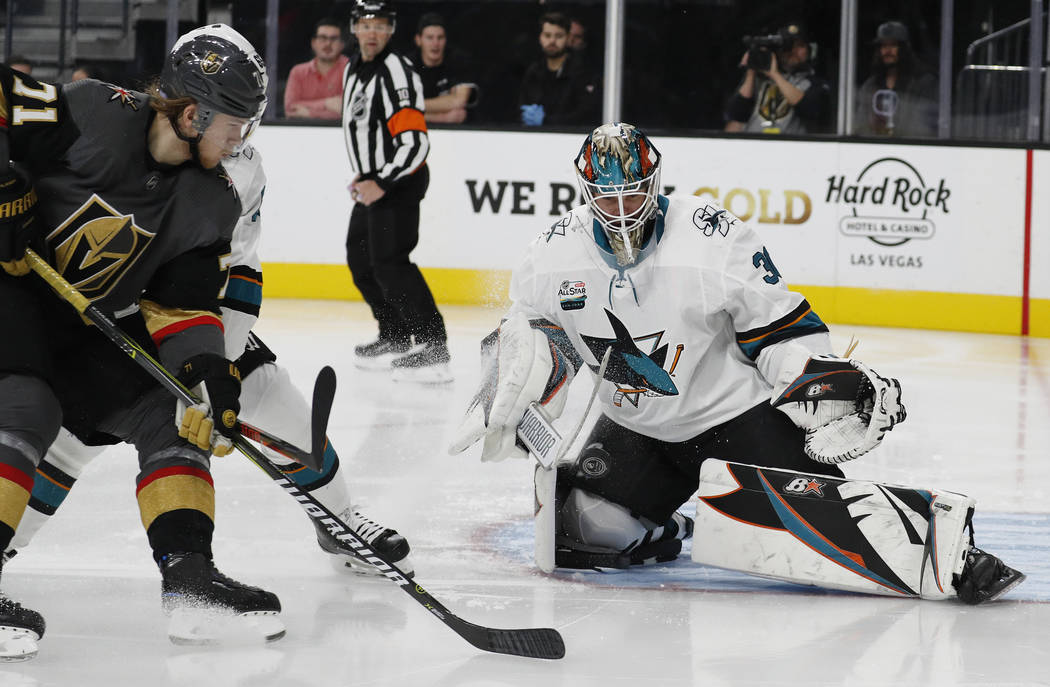 San Jose Sharks goaltender Aaron Dell (30) makes a save against the Vegas Golden Knights during the second period of an NHL hockey game Saturday, Nov. 24, 2018, in Las Vegas. (AP Photo/John Locher)