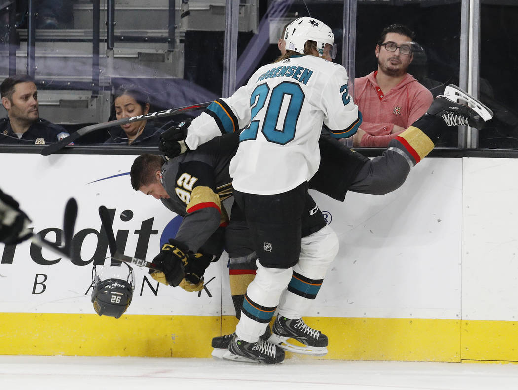 San Jose Sharks left wing Marcus Sorensen (20) checks Vegas Golden Knights left wing Tomas Nosek (92), who loses his helmet during the second period of an NHL hockey game Saturday, Nov. 24, 2018, ...