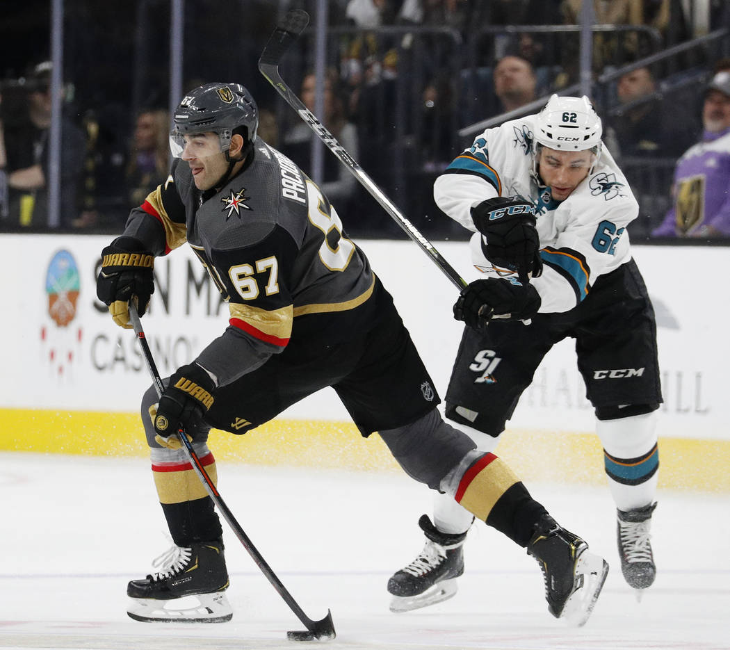 Vegas Golden Knights left wing Max Pacioretty (67) passes the puck as San Jose Sharks right wing Kevin Labanc defends during the third period of an NHL hockey game Saturday, Nov. 24, 2018, in Las ...