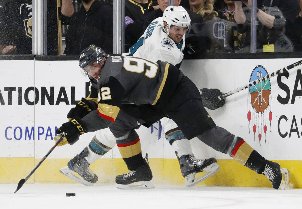 Vegas Golden Knights left wing Tomas Nosek (92) vies for the puck with San Jose Sharks defenseman Marc-Edouard Vlasic (44) during the third period of an NHL hockey game Saturday, Nov. 24, 2018, in ...