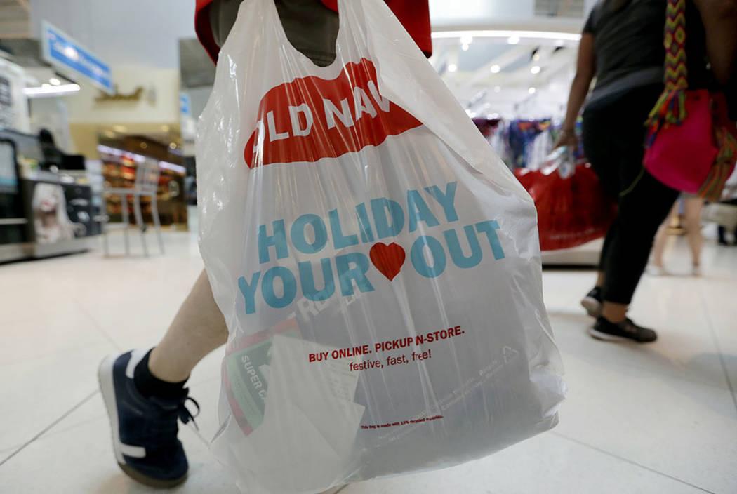 A Black Friday shopper walks through Dolphin Mall on Friday, Nov. 23, 2018, in Miami. (AP Photo/Lynne Sladky)