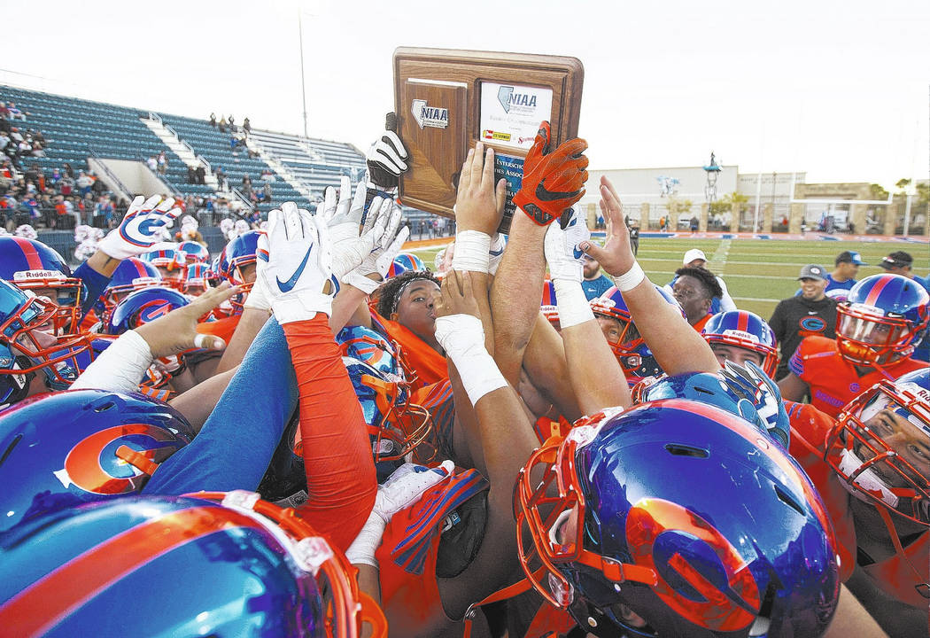 Bishop Gorman celebrates their 42-28 victory over Liberty High School following the NIAA 4A Desert Region championship game at Bishop Gorman High School in Las Vegas on Saturday, Nov. 24, 2018. Ri ...