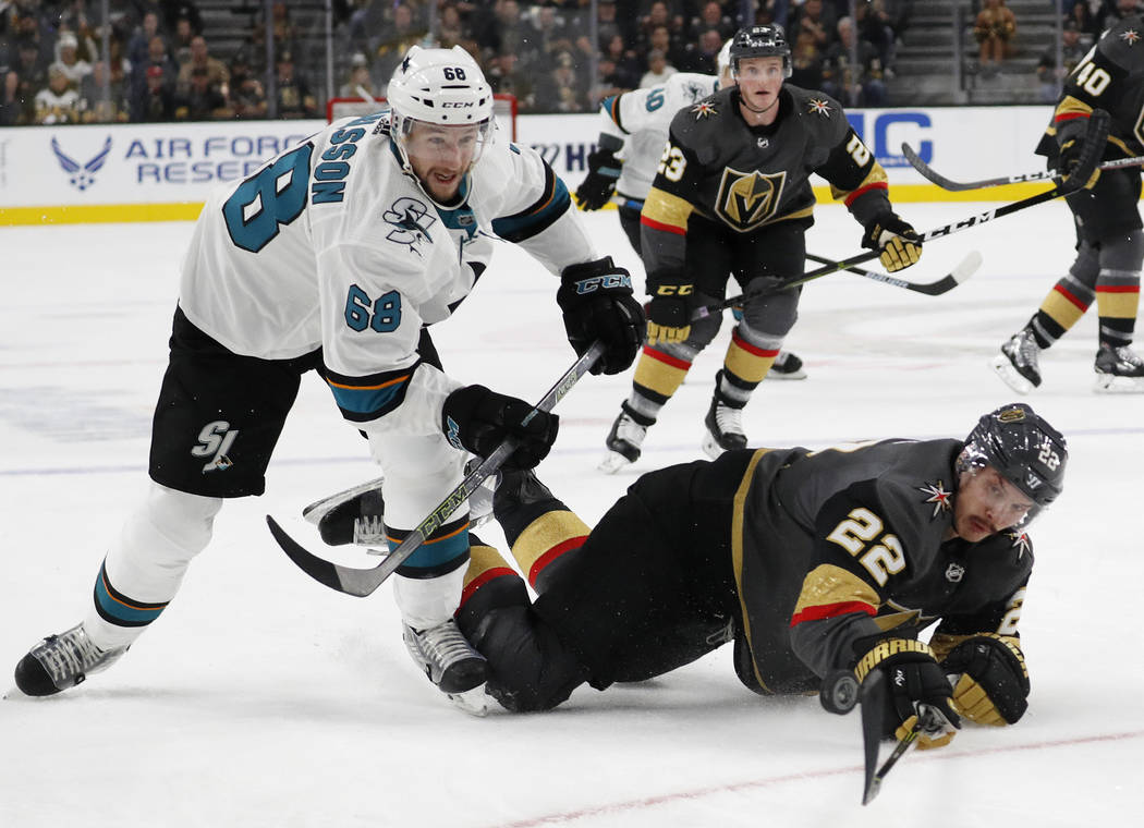 San Jose Sharks center Melker Karlsson (68) and Vegas Golden Knights defenseman Nick Holden (22) vie for the puck during the first period of an NHL hockey game Saturday, Nov. 24, 2018, in Las Vega ...