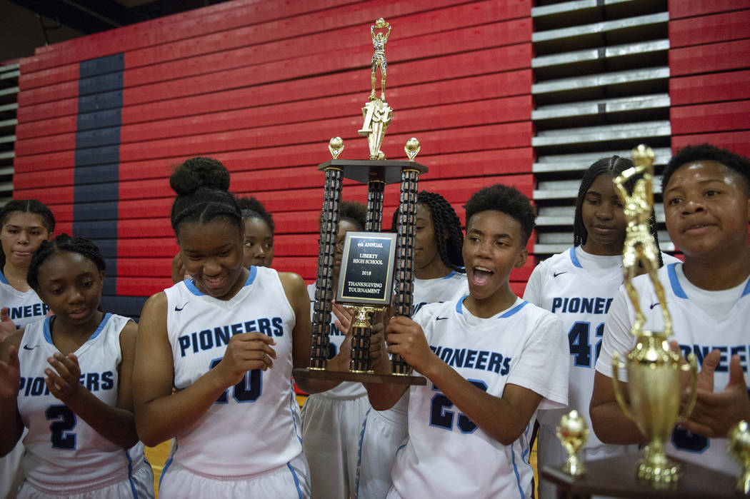 Canyon Springs holds its trophy after defeating Liberty during the second half of the Championship game of the Liberty Thanksgiving Invitational girls basketball tournament at Liberty High School ...