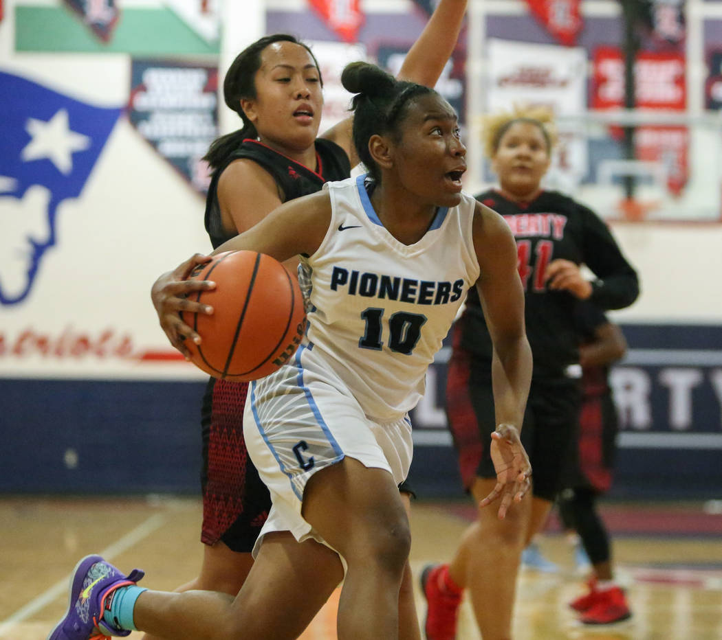 Canyon Spring's Sydnei Collier (10) runs down the court with the ball while under being guarded by Liberty's Tiana Tovia (1) during the second half of the Championship game of the Liberty Thanksgi ...