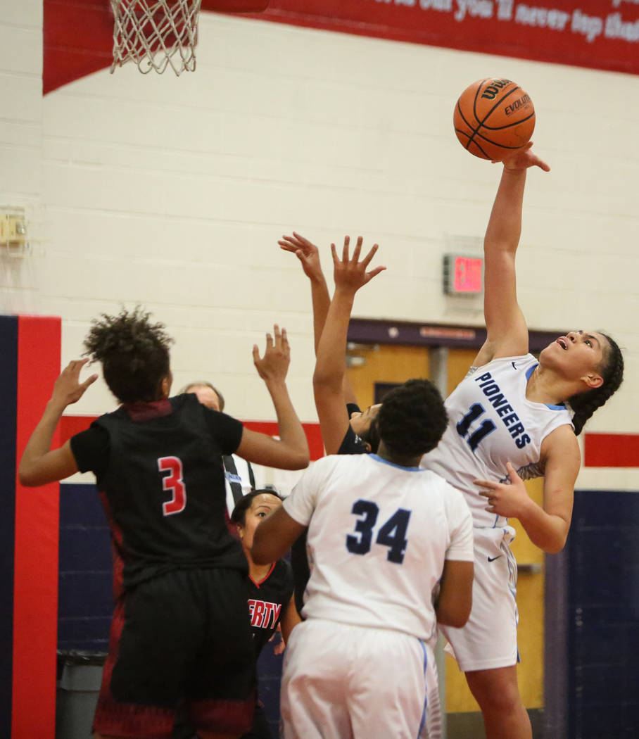Canyon Springs' Jeanette Fine (11) takes a shot during the second half of the Championship game of the Liberty Thanksgiving Invitational girls basketball tournament at Liberty High School in Hende ...