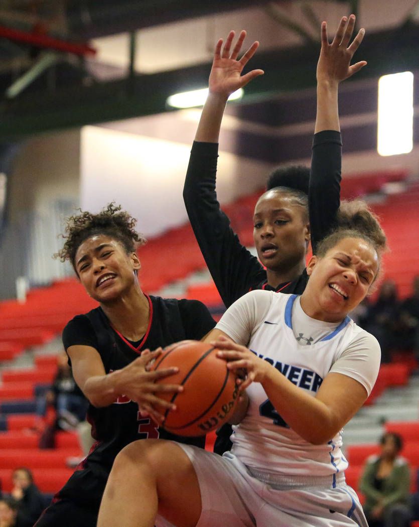 Liberty's Journie Augmon (3) and Olivia Children (23) fight for the ball against Canyon Spring's Jhane Richardson (4) during the first half of the Championship game of the Liberty Thanksgiving Inv ...
