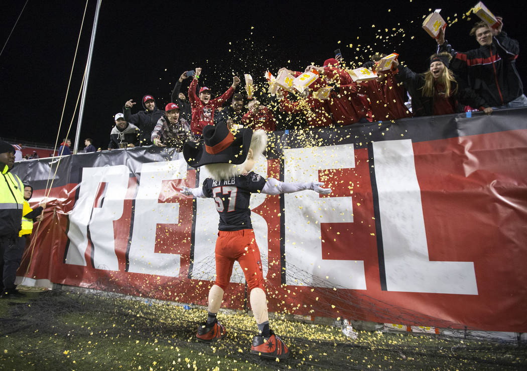 UNLV Rebels mascot Hey Reb! gets covered in popcorn by fans after Rebels quarterback Armani Rogers scored a touchdown against the Nevada Wolf Pack during the second half of an NCAA football game a ...