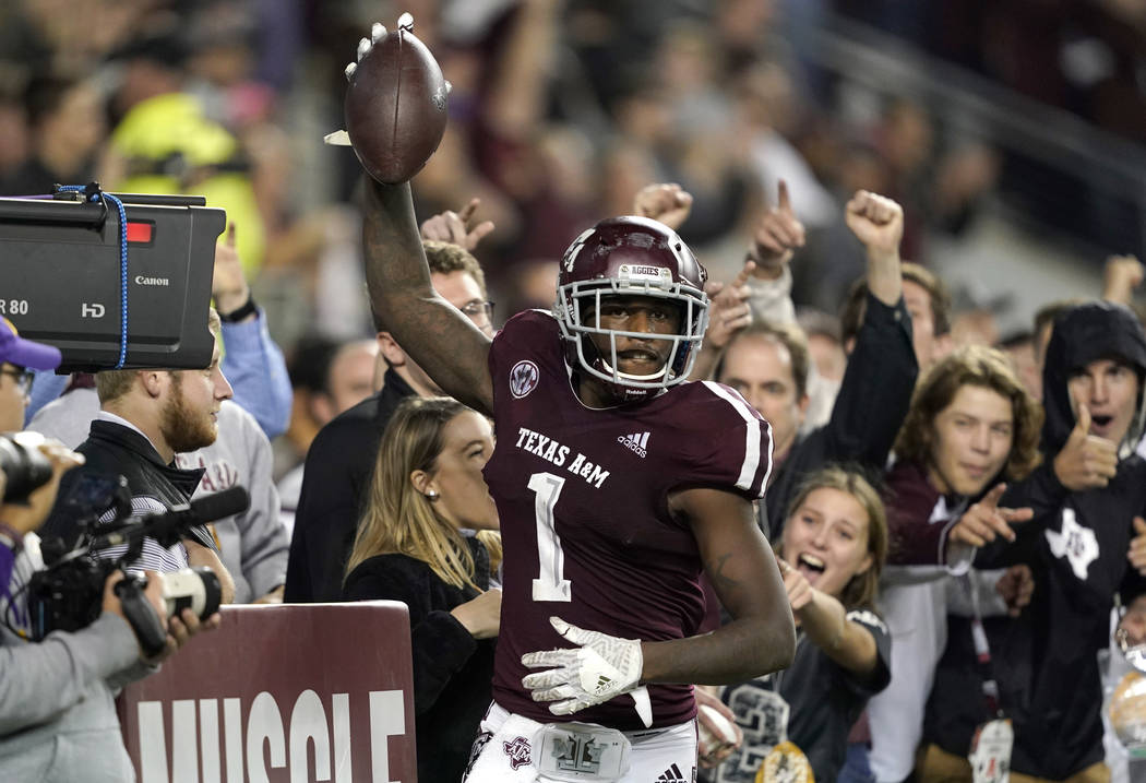 Texas A&M wide receiver Quartney Davis (1) celebrates after catching a touchdown pass during the seventh overtime of an NCAA college football game against LSU Saturday, Nov. 24, 2018, in Colle ...
