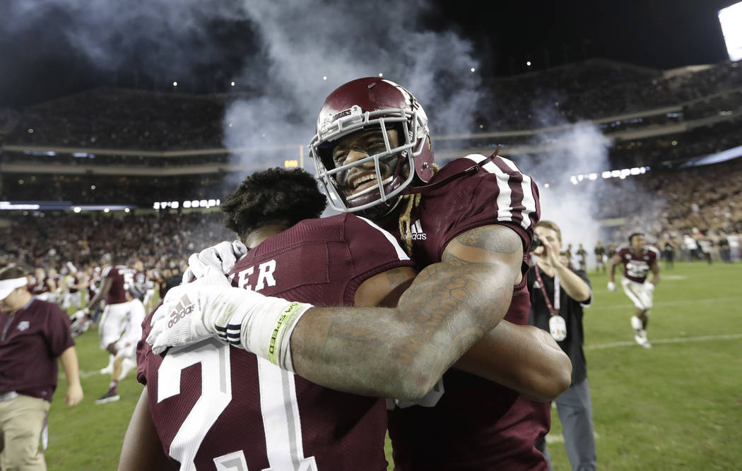 Texas A&M wide receiver Kendrick Rogers, right, celebrates with Charles Oliver (21) after an NCAA college football game against LSU Saturday, Nov. 24, 2018, in College Station, Texas. Texas A& ...