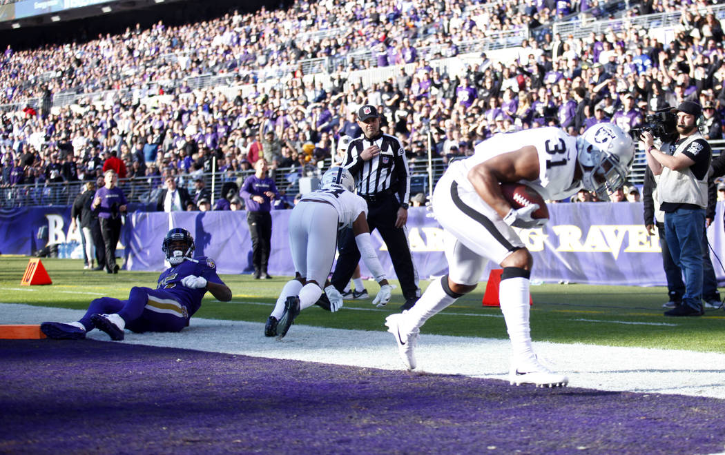 Oakland Raiders strong safety Marcus Gilchrist (31) intercepts a ball tipped by Oakland Raiders cornerback Gareon Conley (21) that was intended for Baltimore Ravens wide receiver Michael Crabtree ...
