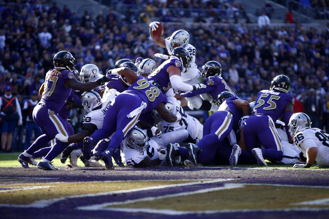 Oakland Raiders running back Doug Martin (28) scores a touchdown during the first half of an NFL game against the Baltimore Ravens in Baltimore,Md., Sunday, Nov. 25, 2018. Heidi Fang Las Vegas Rev ...