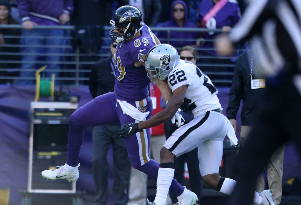 Baltimore Ravens tight end Mark Andrews (89) makes a catch as Oakland Raiders cornerback Rashaan Melvin (22) goes to tackle him during the first half of an NFL game in Baltimore,Md., Sunday, Nov. ...