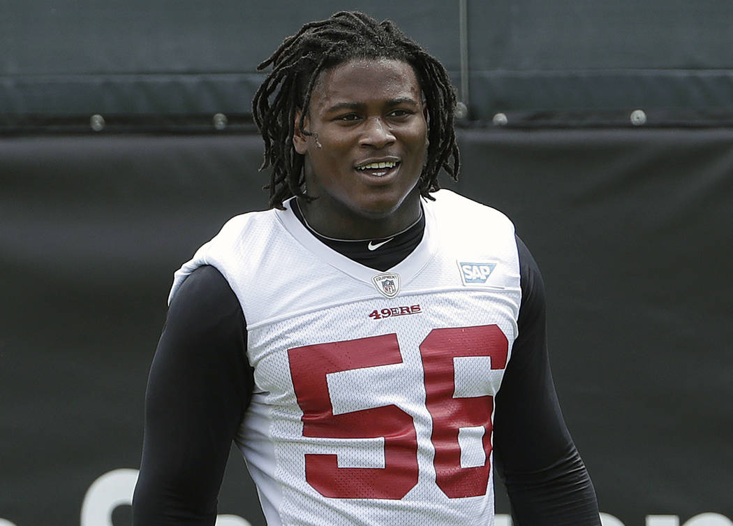 In this May 30, 2018, file photo, San Francisco 49ers linebacker Reuben Foster walks on the field during a practice at the team's NFL football training facility in Santa Clara, Calif. Foster was a ...