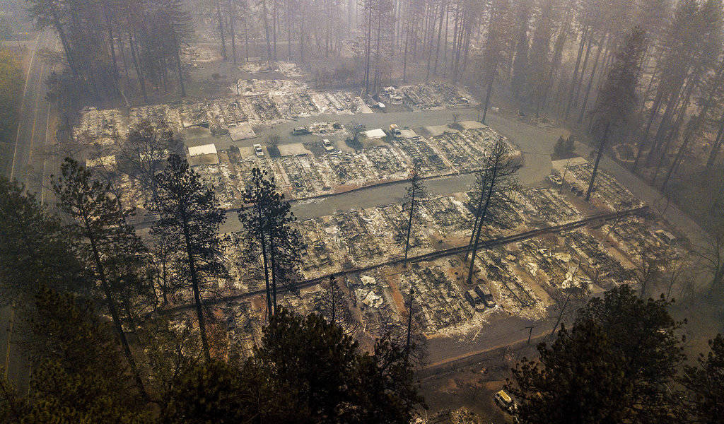 In this Nov. 15, 2018, file photo, residences leveled by the wildfire line a neighborhood in Paradise, Calif. The massive wildfire that killed dozens of people and destroyed thousands of homes has ...