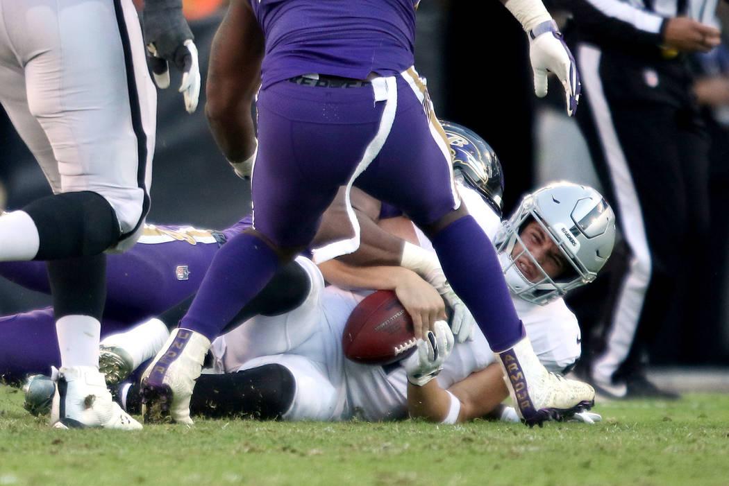 Oakland Raiders quarterback Derek Carr (4) is sacked by Baltimore Ravens outside linebacker Matt Judon (99) as Oakland Raiders offensive guard Kelechi Osemele (70) and offensive tackle Brandon Par ...