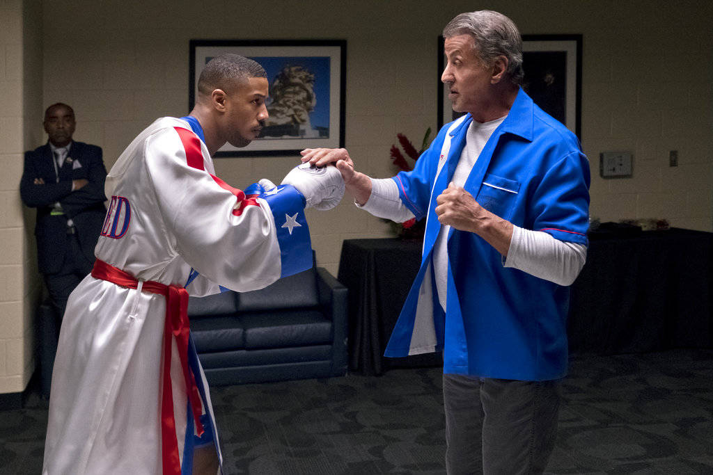 """Michael B. Jordan, left, and Sylvester Stallone in a scene from """"Creed II."""" The Rocky spinoff """"Creed II"""" has placed second with $35.3 million from the weekend and $55.8 million since Wednesday ..."""