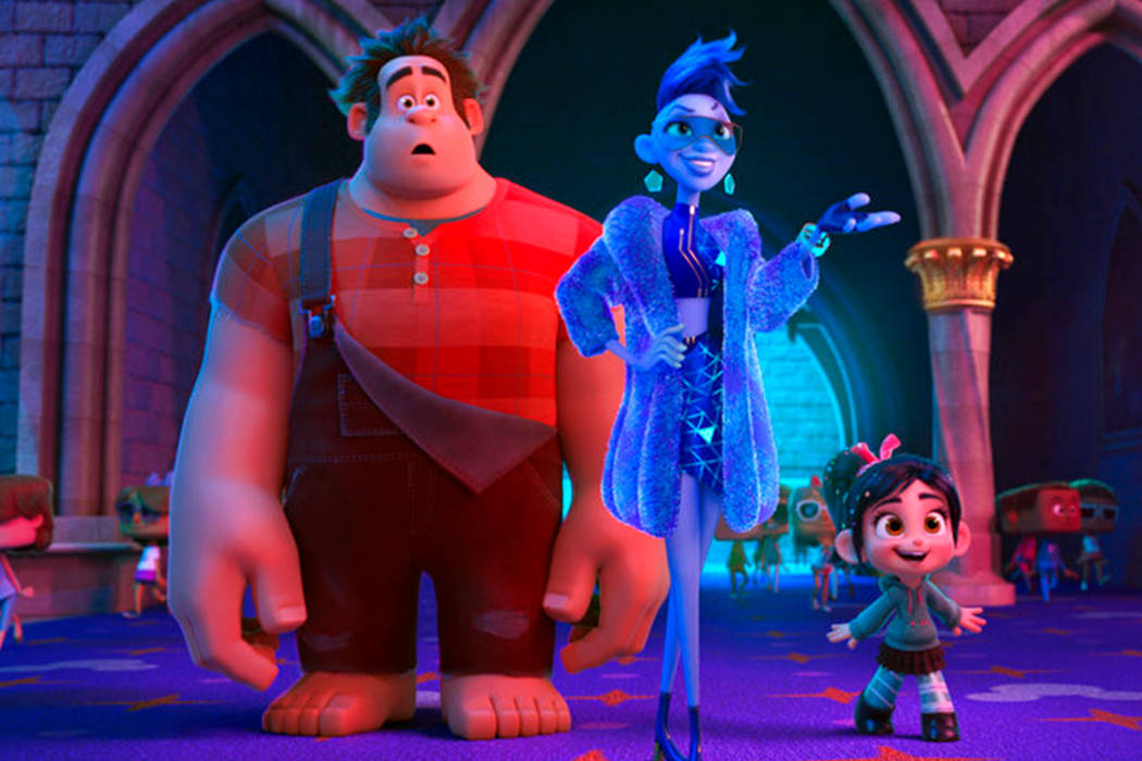"""This image released by Disney shows characters, from left, Ralph, voiced by John C. Reilly, Yess, voiced by Taraji P. Henson and Vanellope von Schweetz, voiced by Sarah Silverman in a scene from """" ..."""