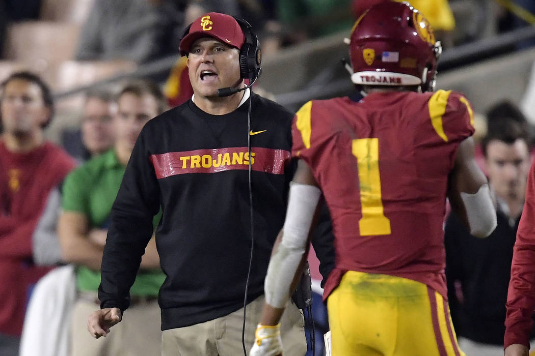 Southern California coach Clay Helton, left, yells to his team as Southern California wide receiver Velus Jones Jr. walks off the field during the second half of an NCAA college football game agai ...